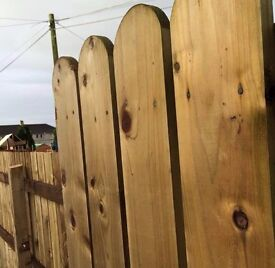 treated round top fence boards