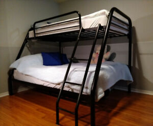 Solid bunk bed including full and twin mattresses