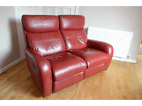 Violino deep red leather two seater reclining sofa. Contemporary design, excellent condition.