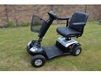 Kymco Mobility Scooter. As new. 20 mile range. includes charger and accessories