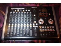 Tascam DP-02 eight channel multi track digital recorder with CD burner and effects.