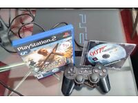 Play station 2 black console with 2 games and controller (SPCH-39003)