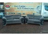 3 and 2 seater sofa in black fabric and corderoy