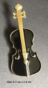 A wonderful violin and treble clef pin/brooch for any musician