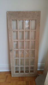 Rustic antique cupboard doors with beveled glass panes