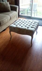 Ottoman and antique mirrored side table