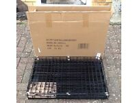 Dog/Cat Pet Cage New and Unused, that measures 78x55x10cm.