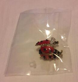 New pair of women's ladybug stud earrings