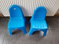 2 blue plastic children's chairs