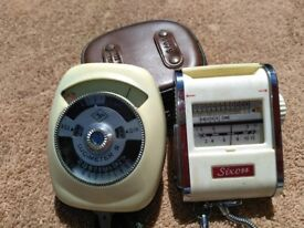 Two antique light meters in working order.