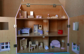 Large wooden dolls' house with furniture and 16 dolls