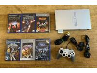 PlayStation 2 console with Star Wars games. PS2