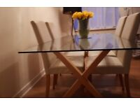 Glass dining room table & leather chairs