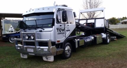 Towing and tilt tray service $100 fixed price