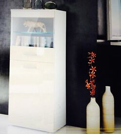 2 Cream gloss display cabinets can be sold seperate