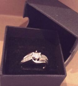 Beautiful 9 carat white gold with a diamond engagement ring - size O