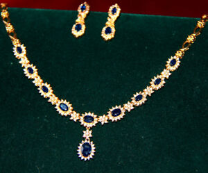 SIMPLY STUNNING 14 CARAT GOLD DIAMOND AND SAPPHIRE SET