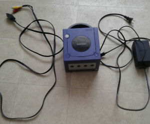 Purple GameCube with cords