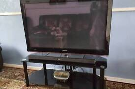 SAMSUNG 50 INCH TV AND BLACK GLASS TV STAND