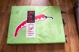 Red chili bouldering/rock climbing mat