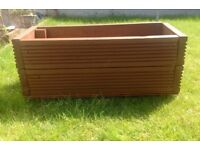 Medium handmade garden planter for sale. Made from reclaimed decking. Pre treated