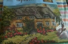 New tapestry kit. Picture is of a thatched cottage with a flower garden.