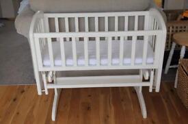 White slide and glide crib