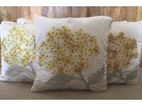 5x Laura Ashleigh Cushions - Ivory and yellow case with feather cushions.