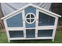 Large rabbit hutch and rain cover - nearly new
