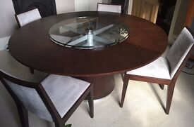 Round Dining Table and Four Upholstered Chairs. Dark wood veneer with patterned glass Lazy Susan