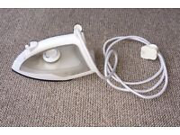 Tesco IR14 steam iron in white, 1200W power, 150ml water tank and ceramic-coated soleplate.