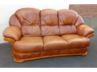 3 seater brown leather sofa.