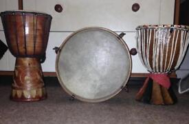 Old drum looks hand made.