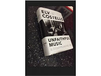 Brand New Elvis Costello autographed book.