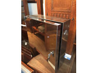 Mirrored Cabinet , with lock and key. sizes L 14 in D 6 in H18 in 2 for £50 0r £30 each..