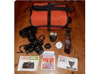 Pentax MV film camera with SMC Pentax-M 50mm f/2 lens, electronic flash, manuals and accessories