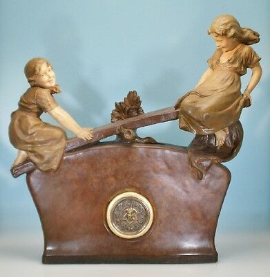 Friedrich Goldscheider, Wien, Uhr mit schaukelnden Kindern, E. Tell