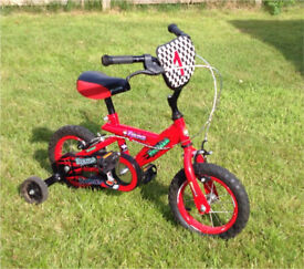 Childs bike with stabilisers.