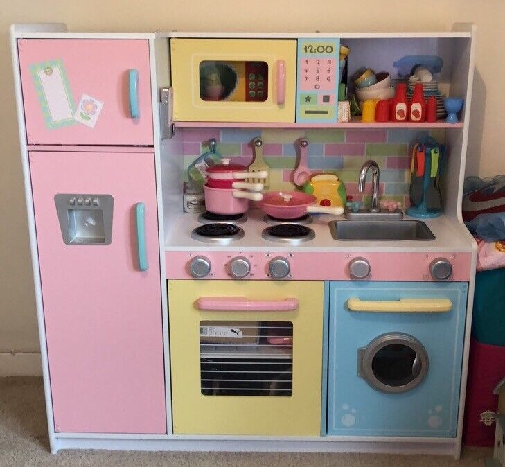Wooden kids kitchen and accessories. Very good condition. Size: 107cm wide  x 109cm high x 40cm deep   in Kilmarnock, East Ayrshire   Gumtree