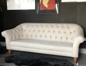 This good quality chesterfield stylish sofa in a light grey colour. it's a good quality M&S sofa