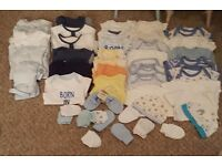 Boy and girl newborn bundles of baby grows and vests