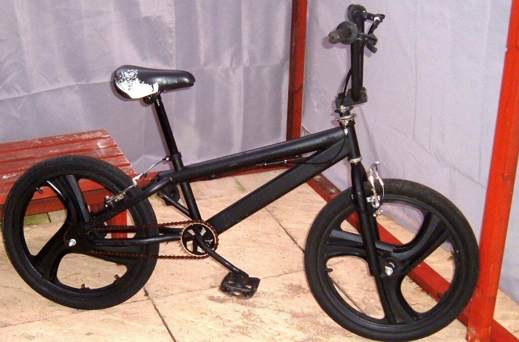 De-badged BMX bike/bicycle with smaller specialised sprocket and Mag wheels