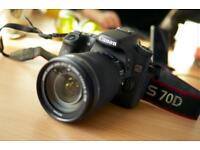 Canon 70d with 18/55mm lens and battery grip.. 20.2mp with built in wifi and flip touch screen