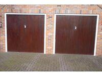 Two matching single 'Garadoor' garage doors.