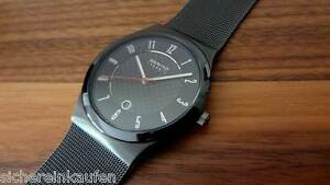 Bering Uhr, flache Armbanduhr Keramik-Carbon, schwarz 32239-242 //Skagen im Shop