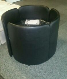 A brand new set of 4 black leatherette storage chairs.