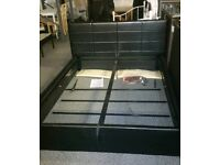A brand new black leather effect double ottoman bed frame.