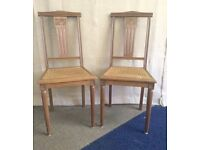 Pair of antique French wooden chairs Paris label