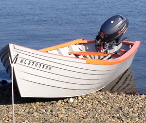 For sale a beautiful dory,motor and trailer.  Ready to set sail!