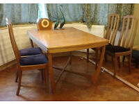 Solid teak dining table and chairs 138x91cm, leaf 61cm, X underframe. Excllent condition.